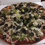 Pizza kitchen special, with sausage, mushroom, bell pepper, onion, and I added black olives.. de