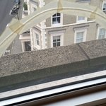 Cracked window in one bedroom apartment repaired with masking tape.
