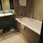 Full bathroom with shower and bath