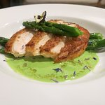 Pan fried chicken breast with garlic veloute and asparagus