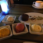 Dessert - three scoops of various flavored sorbets, chocolate cake and ice cream