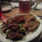 Veal schnitzel with brussel sprouts, German potato salad and a liter of craft beer.