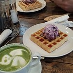 Matcha latte and waffles with ice-cream
