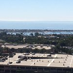 In the foreground Fashion Island Mall, Newport Harbor, and The Big Pond (Pacific Ocean)