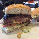 Stuffed burger cut in half.