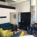 Lounge area, desk and suitcase area
