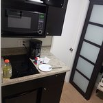 Kitchenette with wardrobe and bathroom door nearby