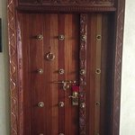 The door to every room is in traditional Swahili Zanzibar style