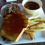 Fries, BBQ beans, Pulled pork, Texas toast and sausage (underneath)