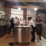 A busy but calm kitchen in full view or customers