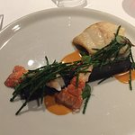 Fish with lobster bisque and black asparagus