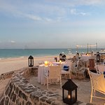Restaurant and beach set-up for evening dining