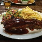 Tennessee BBQ Belly of Pork £12.95 dressed salad & memphis-style sauce with fries.