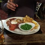 12oz Gammon Steak £12.95 egg or pineapple, homemade chips, onion ring, grilled tomato and peas