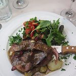 Beef Fillet with bacon, roasted potatoes and salad.