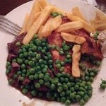 Steak and mushroom pie with chips and peas. Lovely, home/pub kitchen made grub.