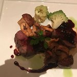 Loin of red deer with chanterelles.