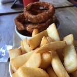 Wagyu Burger with Peroni beer & onion rings..