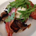 Field mushrooms with parmesan brioche, bacon, poached egg and rocket