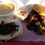 """Dirty"" mashed potatoes, jalapeno grits, pulled pork sandwhich & coleslaw"