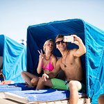 Relax on a cushioned beach cabana
