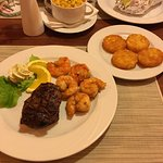 Surf & turf, baked potato and roastet potatoes
