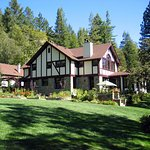 View of Julia Morgan Redwood Grove Main House from lawn.