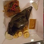 Fresh caught fish wrapped in banana leaves