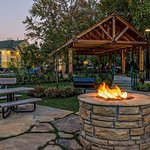 Fire pit with picnic tables and cedar wood pavilion.
