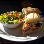 Grilled salmon sandwhich with green salad.