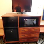 entertainment center, with microwave and minifridge