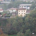 Cream-colored Casa La Pace B&B as seen from Alto Ghivizzano fortress
