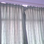 bedroom curtains hanging off runners