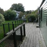 View of deck shielded by trees and warden's cabin