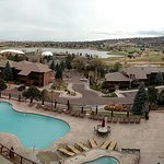 View of resort from the main facilities, you can see the pool, other lodges, golf course.