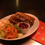 Turkey, bacon and stuffing toastie with cranberry sauce