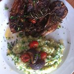 Thick cut karoo lamb cutlets in middle Eastern herbs with potato & pea mash