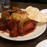 Biryani rice with red chicken and egg plant