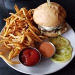 Double Double at Etta's, Seattle. House ground beef burger stacked with slaw, smoked Beecher's j