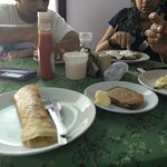 Hearty breakfast - Egg dishes, ham and cheese sandwiches, pancakes., juices, coffee..at Dinha's