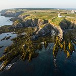 Aerial view of Cape Saint Mary Lighthouse and cliffscape.