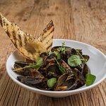 Mussels in a Mediterranean Tomato Butter   watercress, chilies, warm baguett