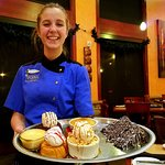 Delivering desserts, Dannielle's beautiful smile epitomizes Tucano's friendly service.