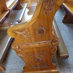 Carving on the pew