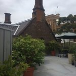 The roof garden is an oasis hidden away at the furthest reaches of the quaint historic hotel.