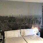 Cool mural on the wall at the head of the bed. Every room is different.