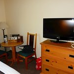 Small table, chairs and flat screen TV