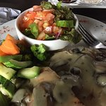 Chicken with mushroom sauce. It included 2 sides and I picked steamed veggies and a salad. Large