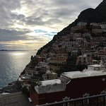 Balcony view of Positano and Sirenuse island.