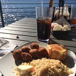Salmon Rockefeller with rice pilaf and hush puppies